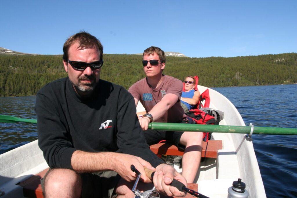 Michael, Tor Håkon and Beverly out fishing on lake Atnasjøen